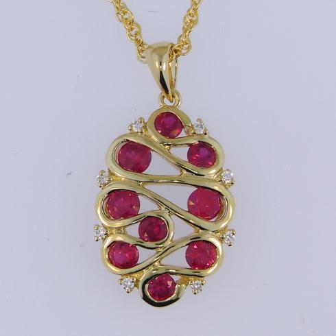 $1,315.00 0.70tcw Genuine Ruby with 0.05tcw Diamonds in 14ky Chain Included