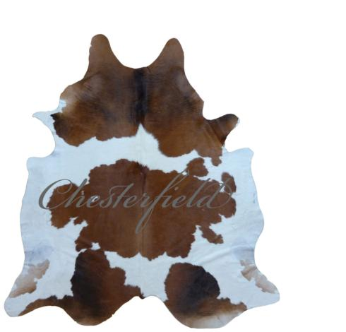 $680.00 BROWN AND WHITE COWHIDE RUG